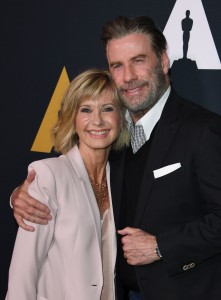 Actors Olivia Newton-John and John Travolta on the red carpet as they