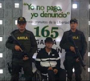 """Wbeimar Ospina, alias """"el Pollo"""", en su silla de ruedas. Cortesía."""