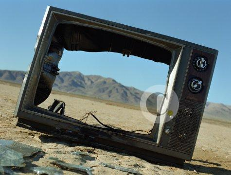Discarded television chassis in desert