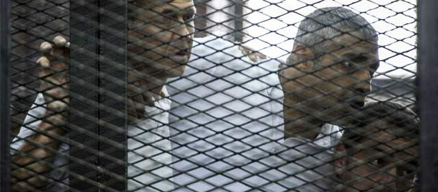 Al-Jazeera news channel's Australian journalist Peter Greste (L) and